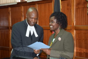 Kwamboka Oyaro, a Complaints Commissioner being sworn in