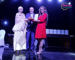 First lady of Chad recieviong an acknoweledgment award of being ambassador of Merck more than a mother by Chairman and CEO of Merck Foundation=